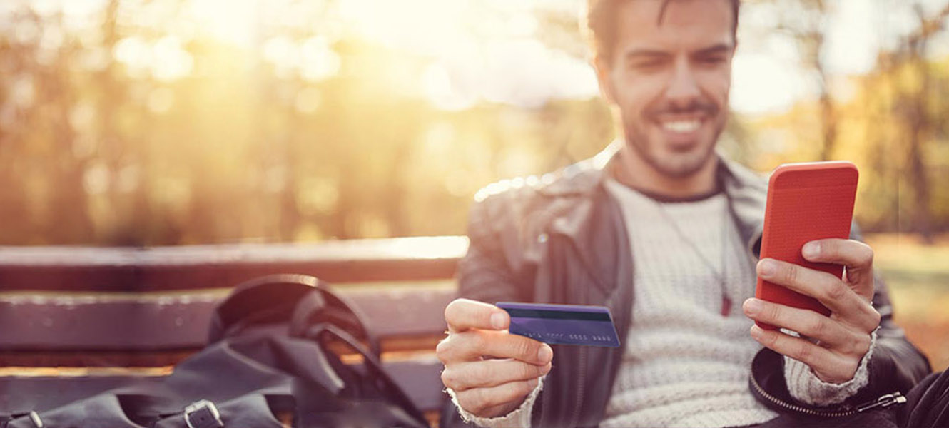 man with a credit card and mobile phone